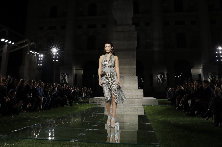 Model Bella Hadid wears a creation as part of the Ferragamo women's Spring/Summer 2018/19 fashion collection, presented in Milan, Italy, Saturday, Sept. 23, 2017. (AP Photo/Luca Bruno)
