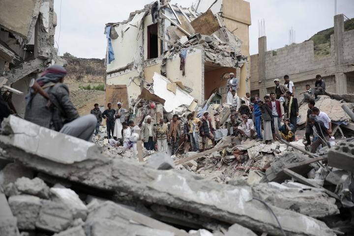 FILE - In this Aug. 25, 2017 file photo, People inspect the rubble of houses destroyed by Saudi-led airstrikes in Sanaa, Yemen. The Monday, Sept. 25, 2017, Kurdish independence referendum in Iraq is the latest in a series ofmoves toward formal secession or de facto fragmentation caused by conflict, race or religion in the Middle East. It's a trend viewed with considerable alarm in a region that had seriously flirted with merging its nations in post-colonial years more than a half century ago. (AP Photo/Hani Mohammed, File)