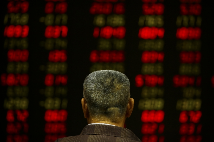 A Chinese investor monitors stock prices at a brokerage house in Beijing, Tuesday, Sept. 26, 2017. Asian stocks were little changed Tuesday as investors watched U.S.-North Korean tensions after a decline in tech shares dragged down Wall Street. (AP Photo/Mark Schiefelbein)
