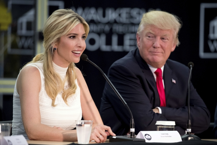 FILE - In this June 13, 2017, file photo, President Donald Trump, right, listens as his daughter, Ivanka Trump, speaks at a workforce development roundtable at Waukesha County Technical College in Pewaukee, Wis. It is no secret that the bulk of Ivanka Trump's merchandise comes from China. But just which Chinese companies manufacture and export her handbags, shoes and clothes is more secret than ever, an Associated Press investigation has found. Since she took on her White House role at the end of March, 90 percent of the shipments of her merchandise do not include public disclosure of the companies that sent the goods to the U.S., data shows. (AP Photo/Andrew Harnik, File)