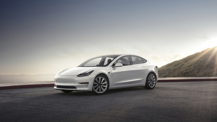 This photo provided by Tesla shows the 2017 Tesla Model 3, a compact electric sedan that offers two levels of range. It's the newest model from Tesla and slots below the Model S sedan in the company's lineup. (Courtesy of Tesla Inc. via AP)