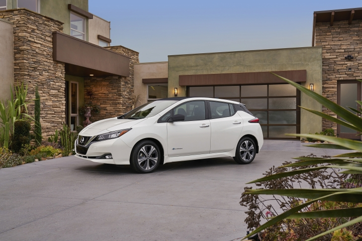 This photo provided by Nissan shows the 2018 Nissan Leaf, a redesigned version of one of the most popular electric vehicles ever produced. It goes on sale in early 2018, with a starting price just under $31,000. (Courtesy of Nissan North America Inc. via AP)