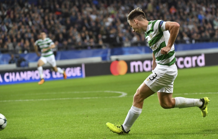Celtic's Kieran Tierney, right, crosses the ball to Celtic's Leigh Griffiths to score the match first goal during a Champions League Group B soccer match between Anderlecht and Celtic at the Constant Vanden Stock stadium in Brussels, Wednesday, Sept. 27, 2017. (AP Photo/Geert Vanden Wijngaert)