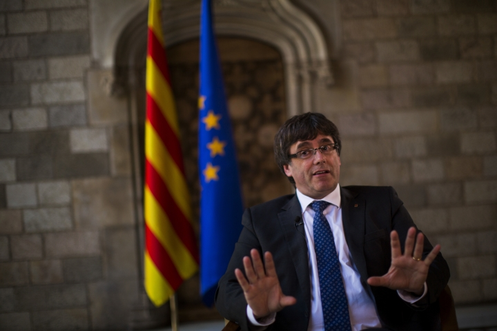 Catalonia's regional president, Carles Puigdemont speaks during an interview with The Associated Press at the Palace of Generalitat or Catalan government headquarters, in Barcelona, Spain, Wednesday, Sept. 27, 2017. (AP Photo/Emilio Morenatti)