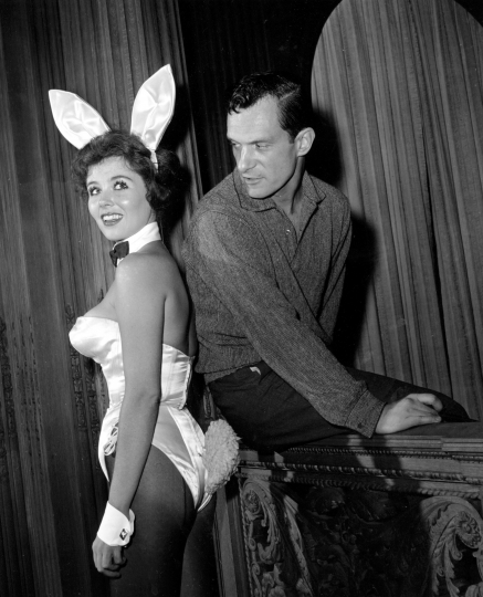 "FILE - In this June 20, 1961 file photo, Playboy magazine publisher Hugh Hefner poses with ""bunny-girl"" hostess Bonnie J. Halpin at Hefner's nightclub in Chicago. Playboy founder and sexual revolution symbol Hugh Hefner has died at age 91. The magazine released a statement saying Hefner died at his home in Los Angeles of natural causes on Wednesday night, Sept. 27, 2017, surrounded by family. (AP Photo/Ed Kitch, File)"