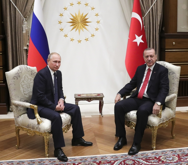 Turkey's President Recep Tayyip Erdogan, right, and Russian President Vladimir Putin pose for a photo prior their talks in Ankara, Turkey, Thursday, Sept. 28, 2017. Putin traveled to Turkey on Thursday for talks with President Recep Tayyip Erdogan on Iraq, Syria and Turkey's decision to purchase a Russian-made missile defense system. (Mikhail Klimentyev, Sputnik, Kremlin Pool Photo via AP)