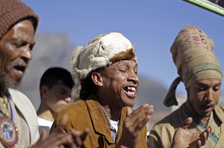 "FILE - In this Thursday, June 28, 2012 file photo, men from the Khoisan ethnic group sing in Cape Town, South Africa, during an event unveiling a new suggested name by them for Cape Town, which translates as, ""Where the clouds gather."" The Khoisan gathering placed emphasis on there race and ethnicity in South Africa. In a paper released Thursday, Sept. 28, 2017 by the journal Science, Mattias Jakobsson of Uppsala University in Sweden and co-authors put the earliest split in Homo sapiens they could detect at 260,000 to 350,000 years ago. That's when ancestors of today's Khoisan peoples diverged from the ancestors of other people, they calculated. (AP Photo/Schalk van Zuydam)"