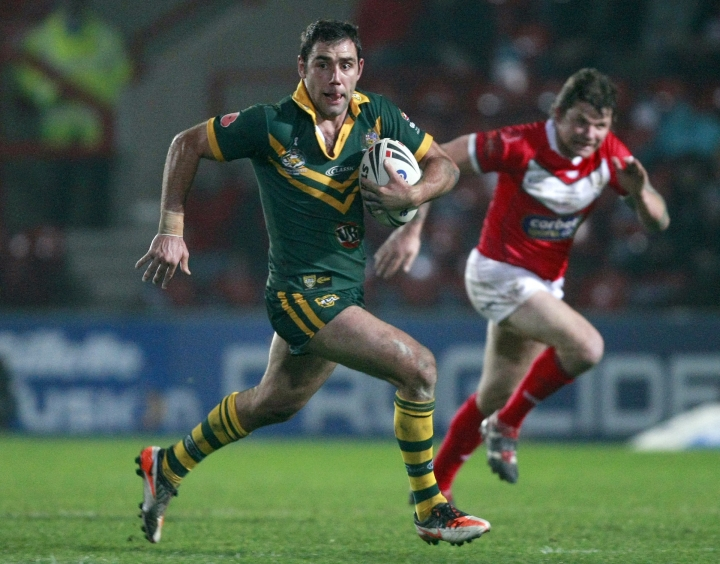 FILE - In this Nov. 13, 2011, file photo, Australia's Cameron Smith is chased by Wales' Lee Briers, right, during their four nations rugby league test match at the Racecourse Ground, Wrexham, Wales. On Sunday, Oct. 1, 2017, the Melbourne Storm, led by veteran captain Smith, take on the upstart North Queensland Cowboys in their title match at Sydney's Olympic stadium. Smith became the oldest player at 34 to win the Dally M Medal as the best player in the league on Wednesday, Sept. 27, 2017. (AP Photo/Tim Hales, File)