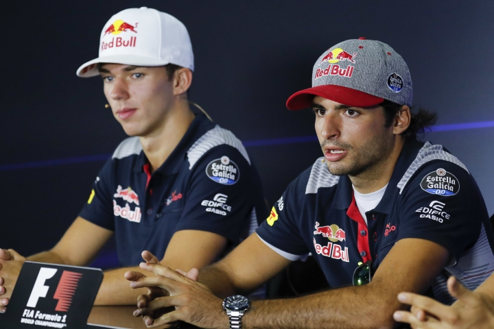 Toro Rosso drivers, Pierre Gasly of France, left, and Carlos Sainz Jr. of Spain attend a press conference at Sepang International Circuit for the Malaysian Formula One Grand Prix in Sepang, Malaysia, Thursday, Sept. 28, 2017. (AP Photo/Vincent Thian)