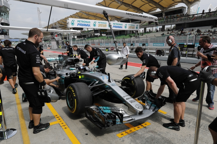 Crew push Mercedes driver Valtteri Bottas of Finland back to the team garage during the second practice at the Sepang International Circuit for the first practice session for the Malaysian Formula One Grand Prix in Sepang, Malaysia, Friday, Sept. 29, 2017. (AP Photo/Vincent Thian)