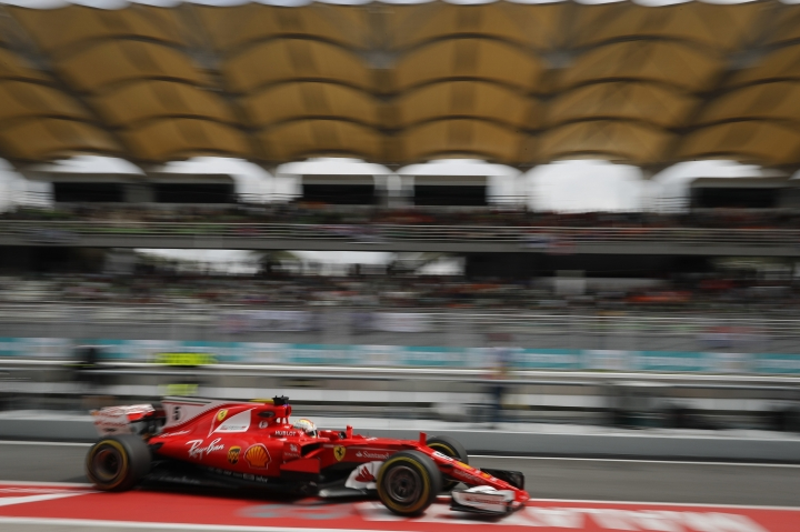 Ferrari driver Sebastian Vettel of Germany drives in the pit lane during during the second practice at the Sepang International Circuit for the first practice session for the Malaysian Formula One Grand Prix in Sepang, Malaysia, Friday, Sept. 29, 2017. (AP Photo/Vincent Thian)