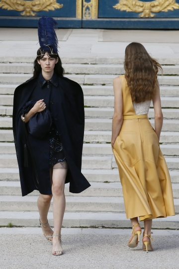 Models wear creations for Nina Ricci Spring/Summer 2018 ready-to-wear fashion collection presented in Paris, Friday, Sept. 29, 2017. (AP Photo/Francois Mori)