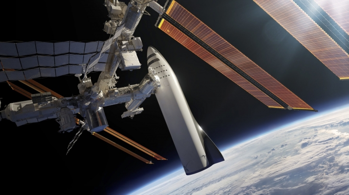 This artist's rendering made available by Elon Musk on Friday, Sept. 29, 2017 shows SpaceX's new mega-rocket design at the International Space Station. With the 350-foot-tall spacecraft, Musk announced that his private space company aims to launch two cargo missions to Mars in 2022. (SpaceX via AP)