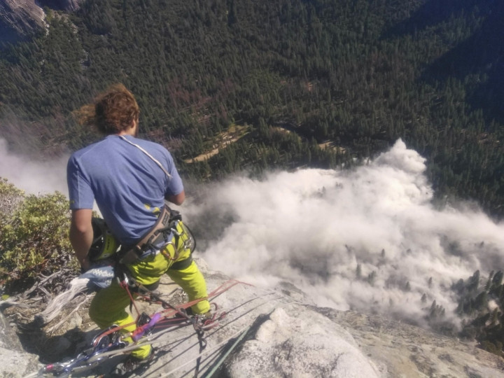 In this photo provided by Peter Zabrok, climber Ryan Sheridan who had just reached the top of El Capitan, a 7,569-foot (2,307 meter) formation, when a rock slide let loose below him Thursday, Sept. 28, 2017, in Yosemite National Park, Calif. It was not immediately clear if there were new casualties, a day after another slab dropped from El Capitan, killing a British climber and injuring a second. (Peter Zabrok via AP)