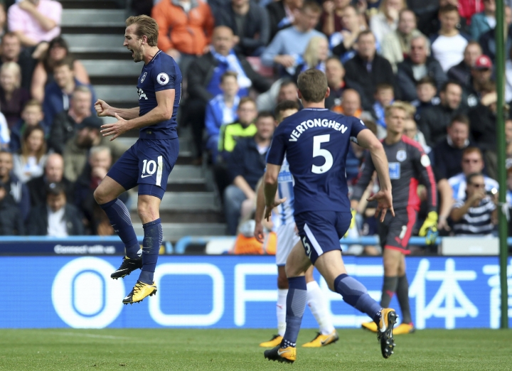 Tottenham Hotspur's Harry Kane celebrates scoring his side's third goal of the game during the English Premier League soccer match between Huddersfield Town and Tottenham Hotspur at the John Smith's Stadium, Huddersfield, England. Saturday, Sept. 30, 2017 (Nigel French/ PA Via AP)