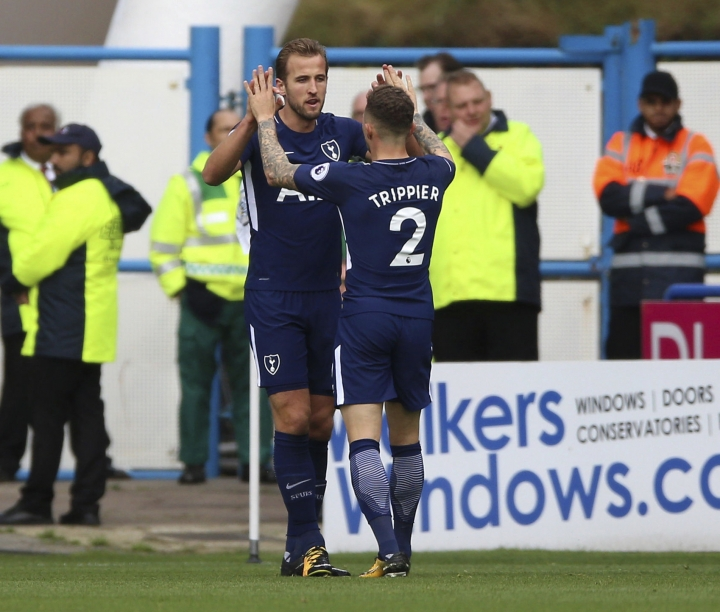 Tottenham Hotspur's Harry Kane celebrates scoring his side's first goal of the game during the English Premier League soccer match between Huddersfield Town and Tottenham Hotspur at the John Smith's Stadium, Huddersfield, England. Saturday, Sept. 30, 2017 (Nigel French/ PA Via AP)