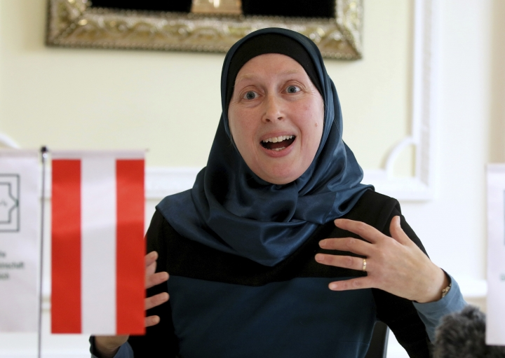 """In this photo taken Wednesday Sept. 27 2017, Carla Amina Baghajati from the Austrian Islamic Religious Community gestures during an interview with The Associated Press in Vienna, Austria. A law prohibiting any kind of full face covering but known popularly as the """"Burqa Ban,"""" takes effect in Austria Sunday Oct. 1, 2017 (AP Photo/Ronald Zak)"""