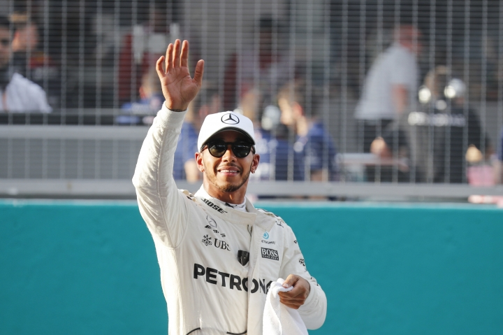 Mercedes driver Lewis Hamilton of Britain waves after the qualifying for the Malaysian Formula One Grand Prix in Sepang, Malaysia, Saturday, Sept. 30, 2017. (AP Photo/Vincent Thian)