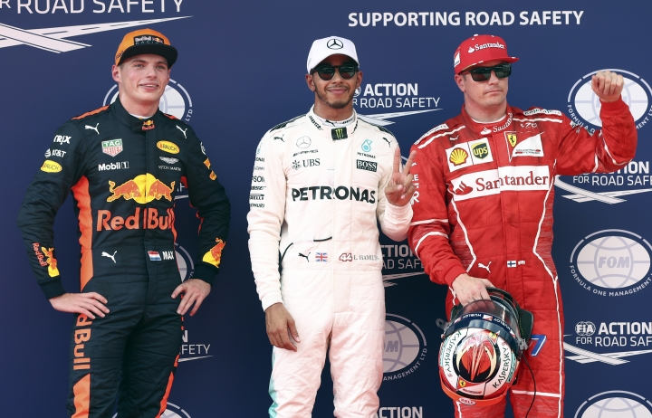 Mercedes driver Lewis Hamilton of Britain, center, posed for photograph after taking pole position after the qualifying round for the Malaysian Formula One Grand Prix in Sepang, Malaysia, Saturday, Sept. 30, 2017. Ferrari driver Kimi Raikkonen of Finland, right, was second and Red Bull driver Max Verstappen of the Netherlands, left, third. (AP Photo/Daniel Chan)