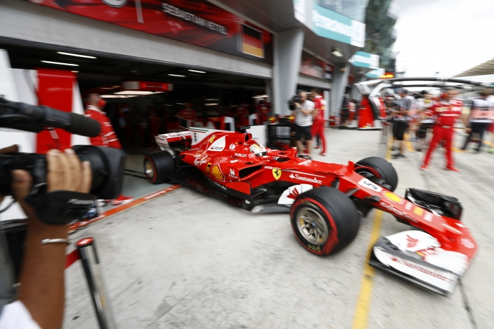 Ferrari driver Sebastian Vettel of Germany steers his car out from his team garage during the third practice session at the Sepang International Circuit for the Malaysian Formula One Grand Prix in Sepang, Malaysia, Saturday, Sept. 30, 2017. (AP Photo/Eric To)