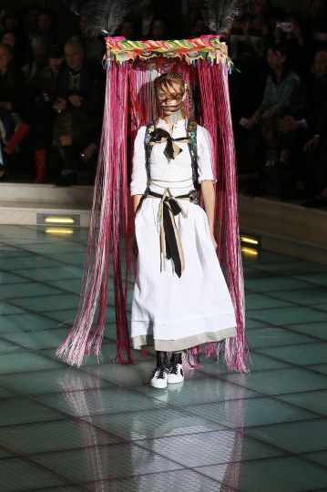 A model wears a creation for Vivienne Westwood Spring/Summer 2018 ready-to-wear fashion collection presented in Paris,Saturday, Sept. 30, 2017. (AP Photo/Francois Mori)