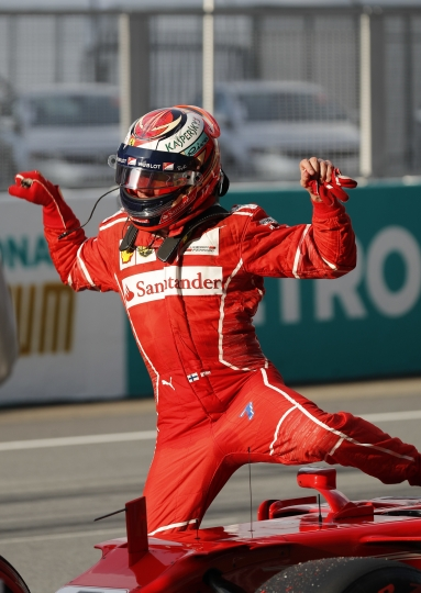 Ferrari driver Kimi Raikkonen of Finland steps out from his car after the qualifying for the Malaysian Formula One Grand Prix in Sepang, Malaysia, Saturday, Sept. 30, 2017. (AP Photo/Vincent Thian)