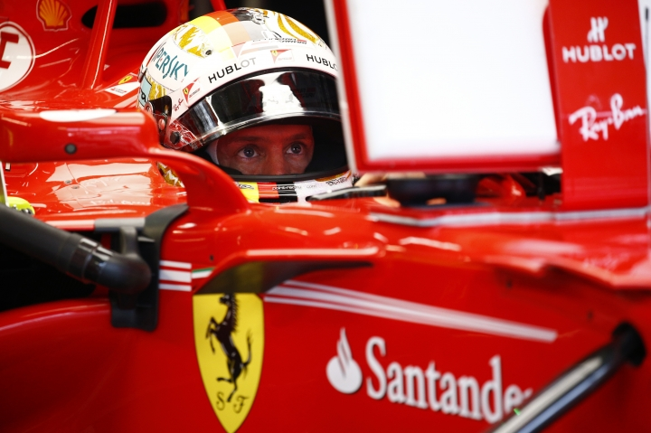 Ferrari driver Sebastian Vettel of Germany sitting in his car prepares for the third practice session at the Sepang International Circuit for the Malaysian Formula One Grand Prix in Sepang, Malaysia, Saturday, Sept. 30, 2017. (AP Photo/Eric To)