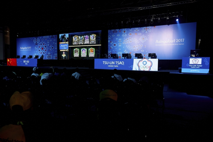"""In this photo taken by LAUREL Photo Services on Tuesday, Sept. 26, 2017, esports competitors play the card game """"Hearthstone"""" at the Asian Indoor and Martial Arts Games in Ashgabat, Turkmenistan. Including competitive computer games, known as esports, could give the Olympics a younger audience and a huge revenue boost from a rapidly growing market, but would be deeply controversial. (David Aliaga/LAUREL Photo Services via AP)"""