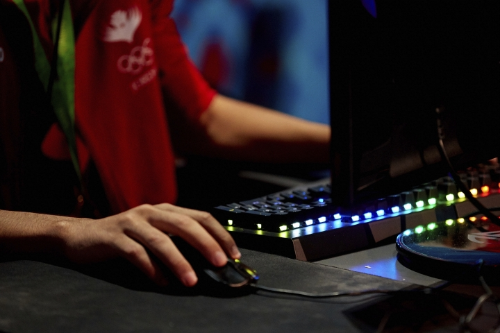 In this photo taken by LAUREL Photo Services on Tuesday, Sept. 26, 2017, an esports competitor takes part in the Asian Indoor and Martial Arts Games in Ashgabat, Turkmenistan. Including competitive computer games, known as esports, could give the Olympics a younger audience and a huge revenue boost from a rapidly growing market, but would be deeply controversial. (David Aliaga/LAUREL Photo Services via AP)