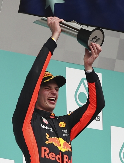 Red Bull driver Max Verstappen of the Netherlands hold this trophy aloft after winning the Malaysian Formula One Grand Prix in Sepang International Circuit in Sepang, Malaysia, Sunday, Oct. 01, 2017. (AP Photo/Daniel Chan)