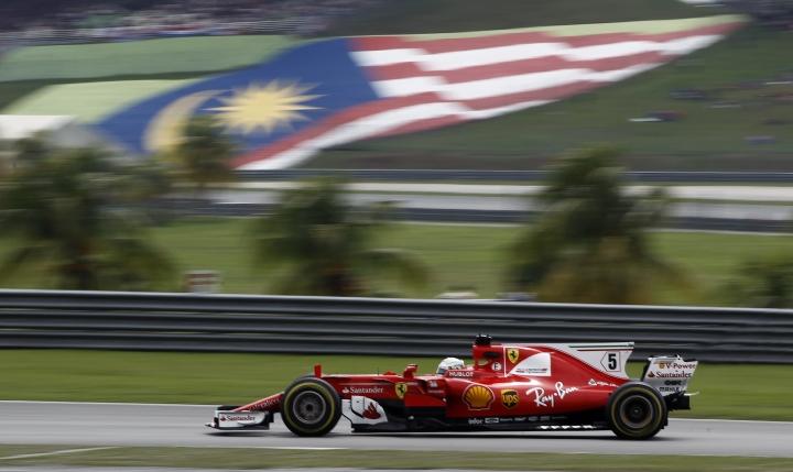 Ferrari driver Sebastian Vettel of Germany steers his car during the Malaysian Formula One Grand Prix in Sepang International Circuit in Sepang, Malaysia, Sunday, Oct. 01, 2017. (AP Photo/Daniel Chan)
