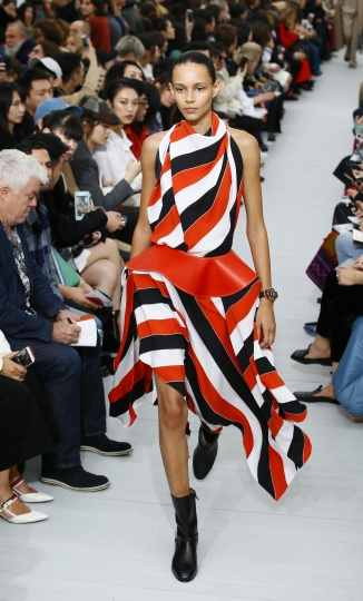 A model wears a creation for Celine Spring-Summer 2018 ready-to-wear fashion collection presented Sunday, Oct.1, 2017 in Paris. (AP Photo/Francois Mori)