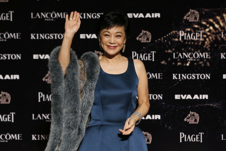 FILE - In this Nov. 21, 2015 fie photo, actress Sylvia Chang arrives at the 52nd Golden Horse Awards in Taipei, Taiwan. Chang is among nominees in the best director category at Golden Horse Awards in November, 2017. (AP Photo/Wally Santana, File)