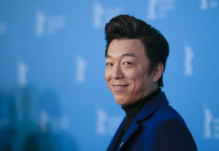 """FILE- In this Feb. 13, 2014 file photo, actor Huang Bo poses for photographers at the photo call for the Film No Man's Land during the International Film Festival Berlinale in Berlin. In the best actor category, past winner Huang Bo (""""The Conformist"""") will face off against four first-time best actor nominees at Golden Horse Awards in November, 2017. (AP Photo/Markus Schreiber, File)"""