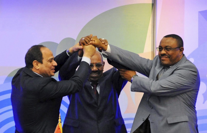 "FILE - In this Monday, March 23, 2015 file image released by the Egyptian Presidency, Sudanese President Omar al-Bashir, center, Egyptian President Abdel-Fattah el-Sissi, left, and Ethiopian Prime Minister Hailemariam Desalegn, right, hold hands after signing an agreement on sharing water from the Nile River, in Khartoum, Sudan. In 2015, Egypt for the first time gave no mention to its ""historic rights"" in a Declaration of Principles it signed with Sudan and Ethiopia. To many experts, this was a naive deal that gave Egypt while giving up everything. The agreement demanded that a tripartite (Egypt, Ethiopia, Sudan) jointly commission international firms to carry impact study then countries impacted should be compensated. It was a ""win-win strategy"" for Ethiopia as the official agency said. (AP Photo/Mohammed Abd el-Moaty, Egyptian Presidency, File)"