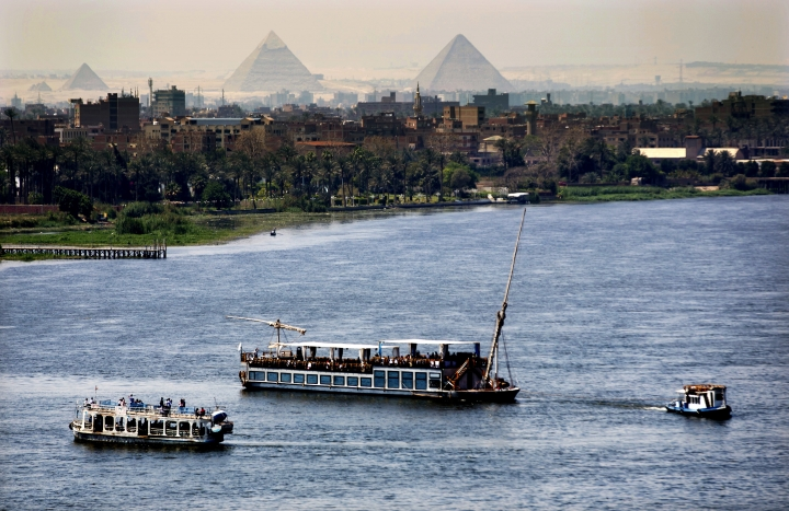 """FILE - In this Monday, April 17, 2017 file photo, Holiday makers enjoy Nile cruises during Sham el-Nessim, or """"smelling the breeze,"""" in Cairo, Egypt. The only reason Egypt has ever existed from ancient times until today is because of the Nile River, which provides a thin, fertile strip of green through the desert. For the first time, the country fears a threat to that lifeline, as Ethiopia rushes to finish a massive hydroelectric dam.(AP Photo/Amr Nabil, File)"""