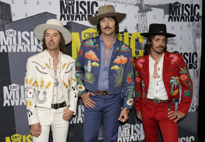 FILE - In this June 7, 2017 file photo, Jess Carson, from left, Mark Wystrach, Cameron Duddy, of Midland, arrive at the CMT Music Awards in Nashville, Tenn. The trio said they have been inspired by all eras of music, from Nirvana and Paul Simon to Hank Williams Sr. and Otis Redding. Wystrach, the lead singer, said they wanted to write songs that stood the test of time and weren't disposable. (Photo by Sanford Myers/Invision/AP, File)