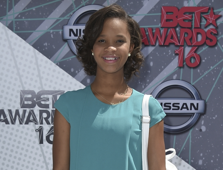 "FILE - In this June 26, 2016 file photo, Quvenzhané Wallis arrives at the BET Awards in Los Angeles. Wallis is releasing two children's books: ""Shai & Emmie Star in Break an Egg! ,"" which chronicles the lives of two best friends at a performing arts school, and ""A Night Out with Mama,"" a picture book inspired by her experience at the Oscars. (Photo by Jordan Strauss/Invision/AP, File)"