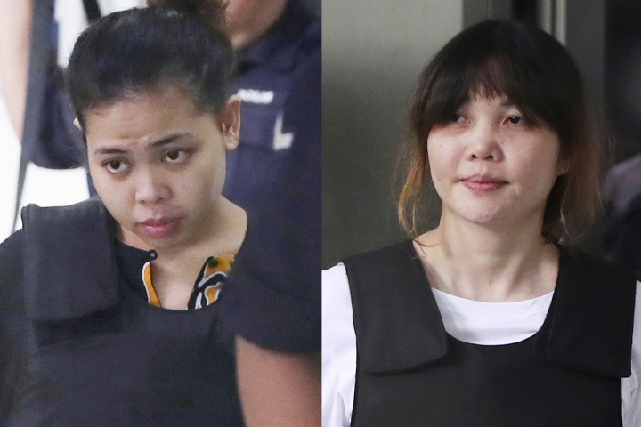In this combination of photos, Indonesian Siti Aisyah, left, and Vietnamese Doan Thi Huong, right, are escorted by police as they leave their court hearing at Shah Alam court house in Shah Alam, outside Kuala Lumpur, Malaysia, Monday, Oct. 2, 2017. Aisyah and Huong, accused of fatally poisoning Kim Jong Nam, the estranged half brother of North Korea's ruler, pleaded not guilty as their trial began Monday in Malaysia's High Court, nearly eight months after the brazen airport assassination that sparked a diplomatic standoff. (AP Photos/Daniel Chan)