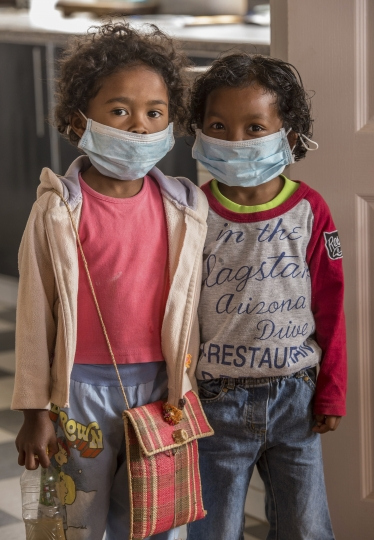 Children wear face masks at a school in Antananarivo, Madagascar, Tuesday, Oct. 3, 2017. Authorities in Madagascar are struggling to contain an outbreak of plague that has killed at least two dozen people, and the government has begun a campaign to disinfect school classrooms in the city. (AP Photo/Alexander JOE)