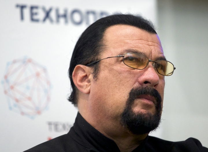 FILE - In this Sept. 22, 2015, file photo, actor Steven Seagal speaks at a news conference, while attending an opening ceremony for a research and development center in Moscow, Russia. Former heavyweight champion George Foreman took to Twitter on Oct. 3, 2017 to challenge Seagal to a 10-round fight. Seagal declined comment. (AP Photo/Ivan Sekretarev, File)