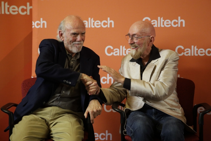 Scientists Barry Barish, left, and Kip Thorne, both of the California Institute of Technology, shake hands during a news conference Tuesday, Oct. 3, 2017, in Pasadena, Calif. Barish and Thorne won the Nobel Physics Prize on Tuesday for detecting faint ripples flying through the universe, the gravitational waves predicted a century ago by Albert Einstein that provide a new understanding of the universe. (AP Photo/Jae C. Hong)