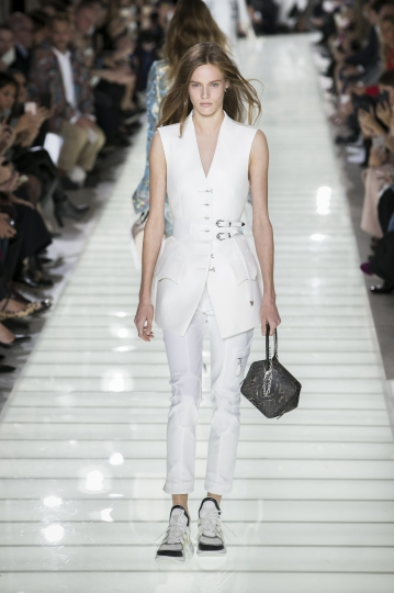 A model wears a creation for Louis Vuitton's Spring-Summer 2018 ready-to-wear fashion collection presented Tuesday, Oct. 3, 2017 in Paris. (AP Photo/Kamil Zihnioglu)