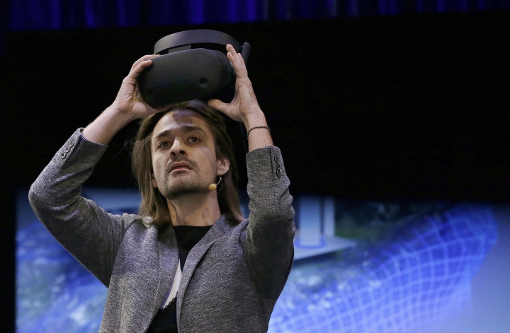 Microsoft Technical Fellow Alex Kipman holds an HMD Odyssey virtual reality headset, Tuesday, Oct. 3, 2017, in San Francisco. Microsoft is touting virtual reality headsets made by other companies in hopes of establishing personal computers running on its Windows 10 operating system as the best way for people to experience artificial worlds. The devices unveiled on Tuesday include a Samsung headset called the HMD Odyssey. The $500 headset requires a connection to a PC running on a Windows 10 update being released Oct. 17. (AP Photo/Ben Margot)