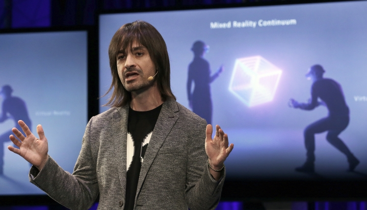 Microsoft Technical Fellow Alex Kipman speaks during a media conference, Tuesday, Oct. 3, 2017, in San Francisco. Microsoft is touting virtual reality headsets made by other companies in hopes of establishing personal computers running on its Windows 10 operating system as the best way for people to experience artificial worlds. The devices unveiled on Tuesday include a Samsung headset called the HMD Odyssey. The $500 headset requires a connection to a PC running on a Windows 10 update being released Oct. 17. (AP Photo/Ben Margot)