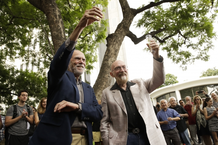 Scientists Barry Barish, left, and Kip Thorne, both of the California Institute of Technology, share a toast to celebrate winning the Nobel Prize in Physics Tuesday, Oct. 3, 2017, in Pasadena, Calif. Barish and Thorne won the Nobel Physics Prize on Tuesday for detecting faint ripples flying through the universe, the gravitational waves predicted a century ago by Albert Einstein that provide a new understanding of the universe. (AP Photo/Jae C. Hong)