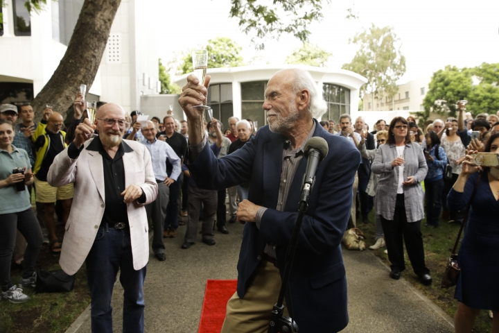 Scientists Barry Barish, center, and Kip Thorne, both of the California Institute of Technology, share a toast to celebrate winning the Nobel Prize in Physics Tuesday, Oct. 3, 2017, in Pasadena, Calif. Barish and Thorne won the Nobel Physics Prize on Tuesday for detecting faint ripples flying through the universe, the gravitational waves predicted a century ago by Albert Einstein that provide a new understanding of the universe. (AP Photo/Jae C. Hong)