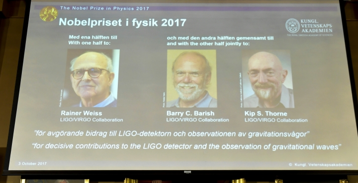 The 2017 Nobel Prize winners in Physics, seen on a projection and are from left, Rainer Weiss, Barry C. Barrish and Kip S. Thorne, at the Royal Swedish Academy of Sciences in Stockholm Tuesday Oct. 3, 2017. (Jessica Gow /TT via AP)