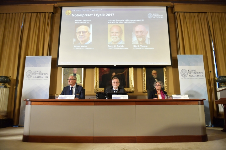 Goran K Hansson, centre, Secretary General of the Royal Swedish Academy of Sciences, announces the 2017 Nobel Prize winners in Physics, from top left, Rainer Weiss, Barry C. Barrish and Kip S. Thorne Tuesday Oct. 3, 2017, at the Royal Swedish Academy of Sciences in Stockholm. (Jessica Gow /TT via AP)