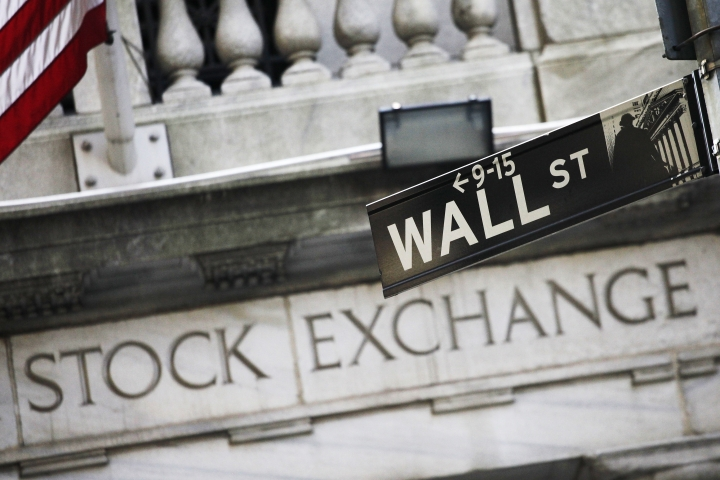 FILE - This July 16, 2013, file photo, shows a Wall Street street sign outside the New York Stock Exchange. U.S. stock indexes ticked higher in early trading on Tuesday, Oct. 3, 2017, and tacked on a bit more to their records set a day earlier. Trading was again very quiet, with only modest moves for bond yields, commodities and other markets. Stock markets were closed in Germany, China and South Korea for holidays. (AP Photo/Mark Lennihan, File)